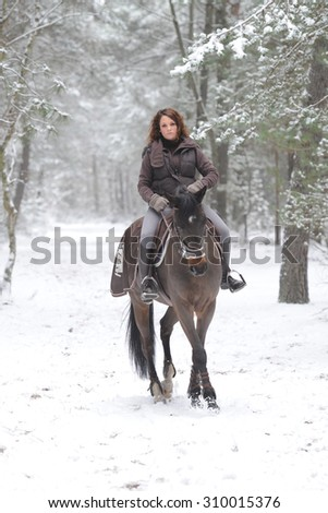 young woman riding in the snow