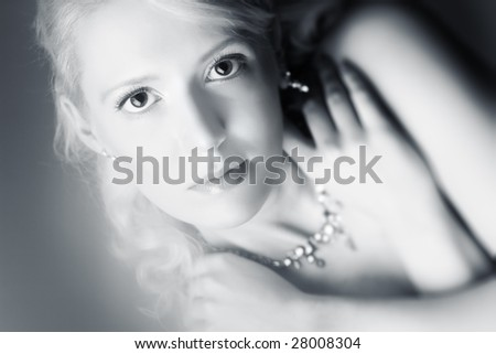 Young woman romantic portrait. Soft silver tint.