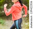 Young woman runner in park - stock photo