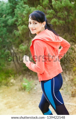 Young woman runner in park
