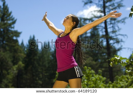 Young woman runner working out in a park