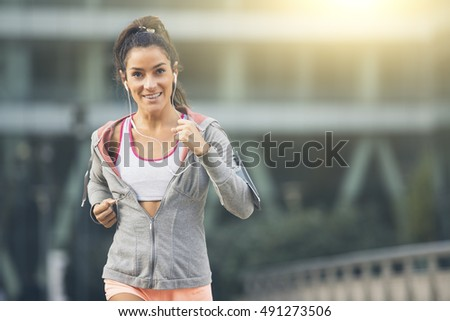 Young woman running in the city street