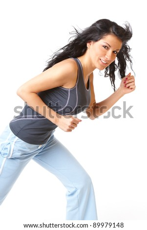 Young woman running, isolated on white background - stock photo