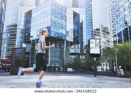 young woman running on urban background