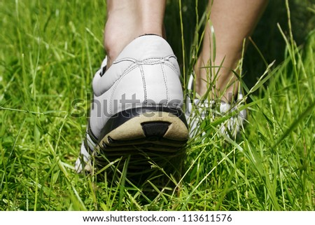 Young woman running outside - stock photo