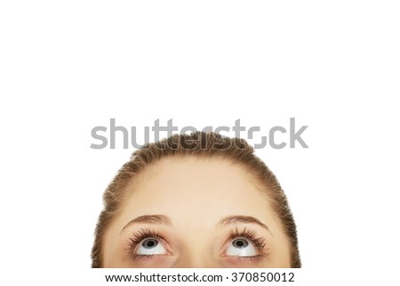 Young woman's eyes looking up.