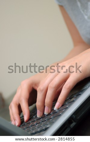Young woman's hands on a computer keyboard - stock photo