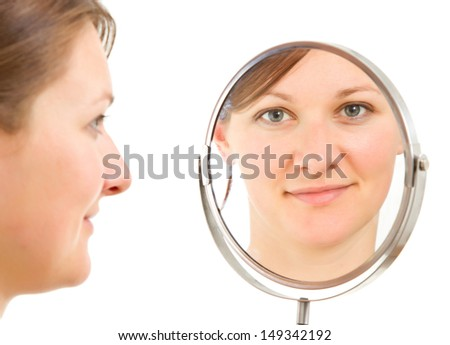 young woman's  isolated portrait reflecting froma  bathroom mirror - stock photo