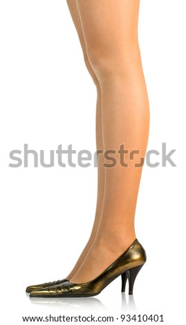young woman's legs wearing  and dark shoes isolated on white - stock photo