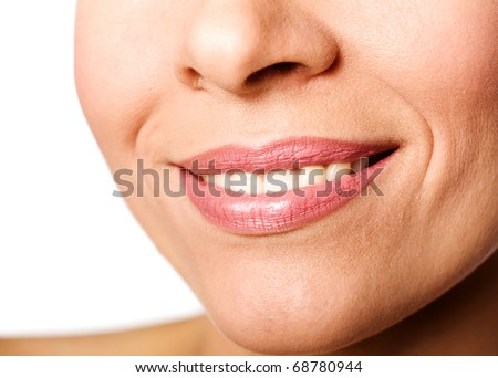 Young woman's Lips smiling close up isolated on white - stock photo