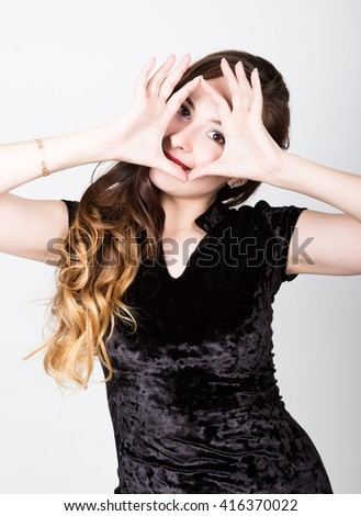 young woman's portrait with different happy emotions. she raised her hands to the face - stock photo