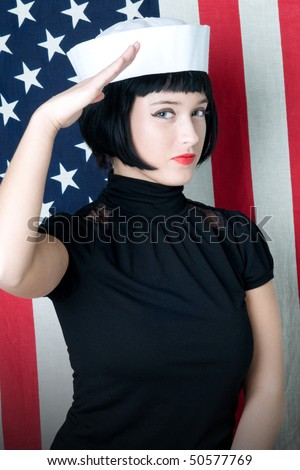young woman saluting in sailor cap with american flag - stock photo
