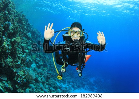 Young woman scuba diver having fun