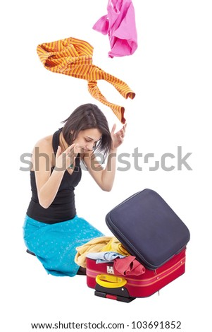 Young woman searching something into the travel bag - stock photo