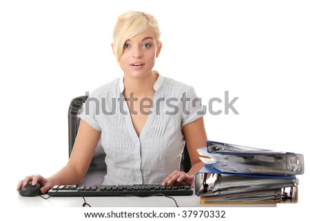 Young woman shocked while working with PC - stock photo