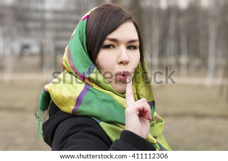 Young woman shoots from her fingers. Only fingers in the focus