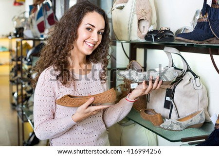 Young woman shopping at fashion shoe store