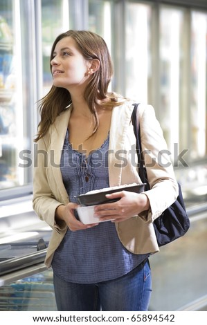 Young woman shopping at supermarket