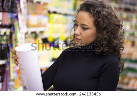 Young woman shopping in the supermarket - stock photo