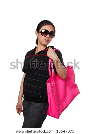 Young woman shopping with a big pink bag, isolated on white. - stock photo