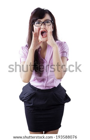 Young woman shout and scream using her hands as tube, studio shoot isolated on white - stock photo