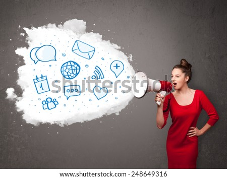 Young woman shouting into loudspeaker and modern blue icons and symbols come out - stock photo