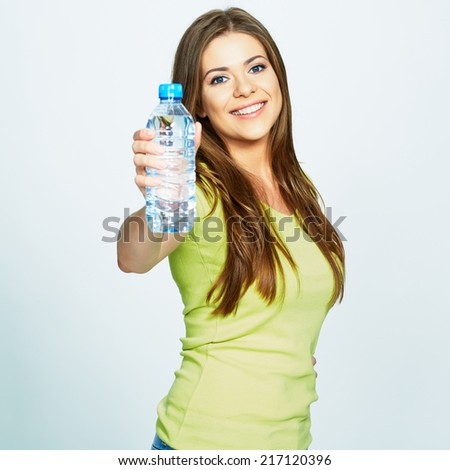 young woman show bottle of water . isolated studio portrait of female model . - stock photo