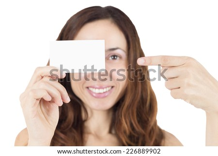 Young woman showing an empty white sign card - stock photo