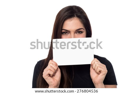 Young woman showing blank banner to camera - stock photo