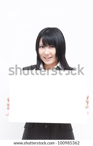 Young woman showing blank billboard - stock photo