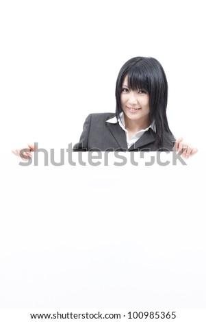 Young woman showing blank billboard, isolated on white background
