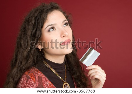 Young woman showing credit card isolated on white background - stock photo