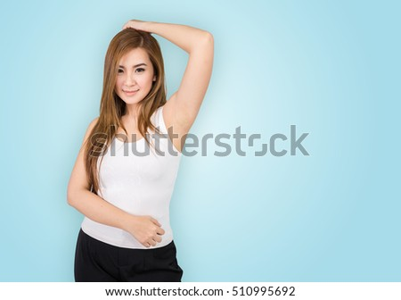 Young woman showing her armpit