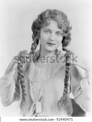 Young woman showing her braids - stock photo