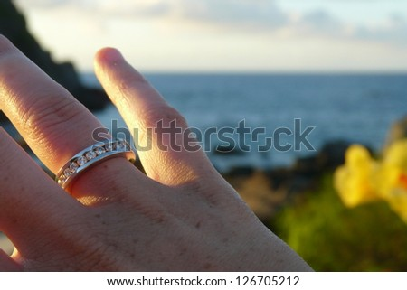 Young woman showing her engange ring while relaxing in Fernando Noronha's beach, Brazil - stock photo