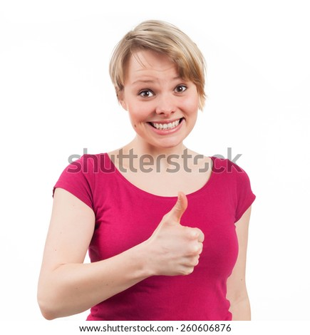 Young woman showing her thumb up, isolated on white - stock photo