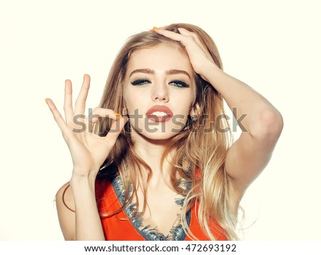 Young woman showing ok gesture isolated on white background