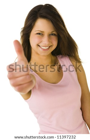 Young woman showing OK. Looking at camera and smiling. Front view. White background. - stock photo