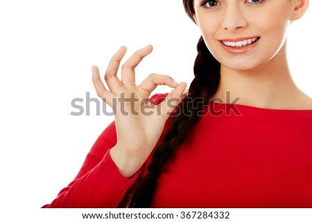 Young woman showing ok sign - stock photo