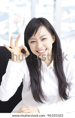 young woman showing OK sign. - stock photo
