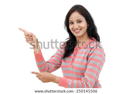 Young woman showing the palm to a blank copy space over white background - stock photo