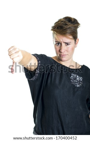 Young woman showing thumbs down gesture on a white background