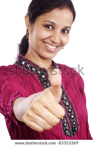 Young woman showing thumbs up gesture - stock photo
