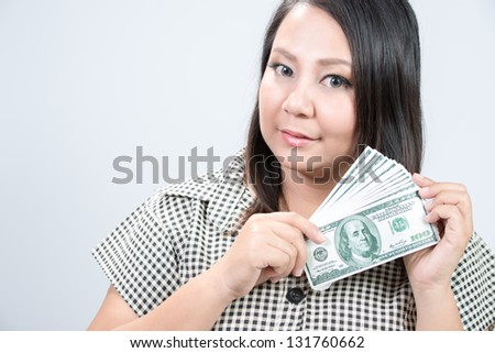 young woman showing 100 US dollar money