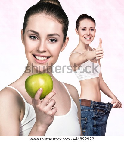 Young woman showing weight loss result - stock photo