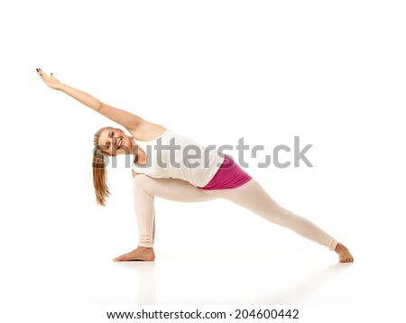 Young woman showing yoga poses over isolated white background - stock photo