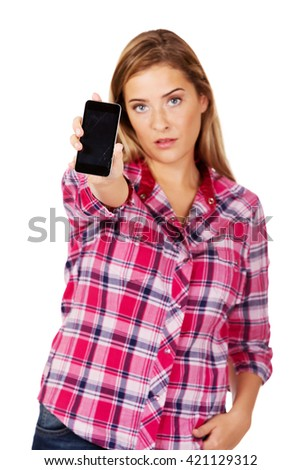 Young woman shows broken mobile phone - stock photo