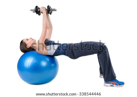 Young woman shows finishing position of Fitball Dumbbell Chest Fly's Workout, isolated on white
