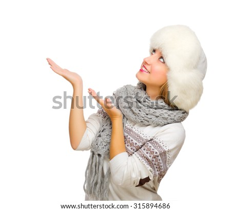 Young woman shows pointing gesture isolated - stock photo