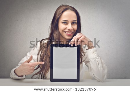 young woman shows tablet - stock photo